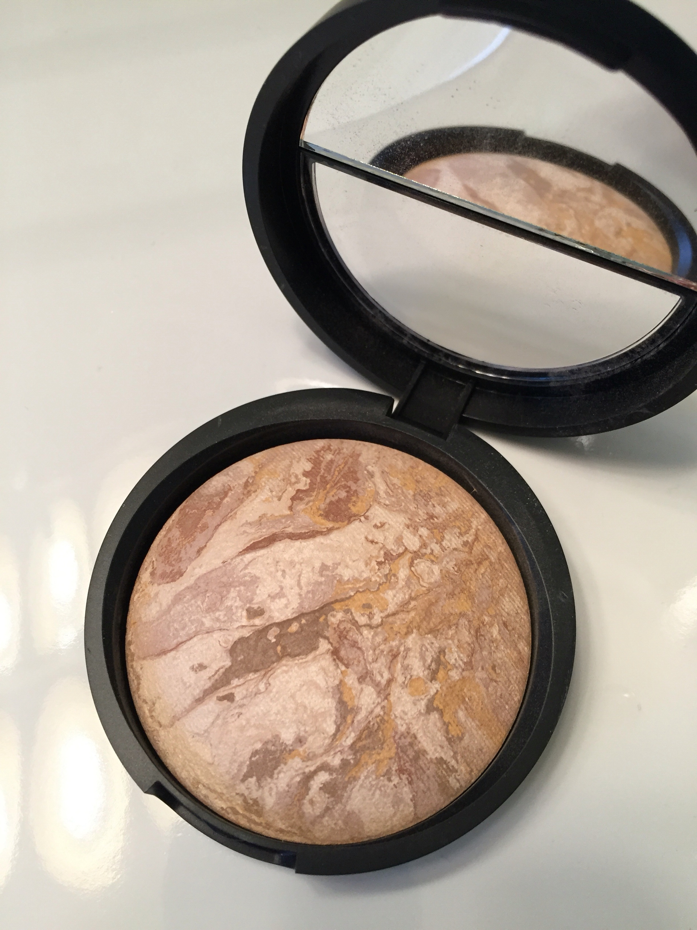 laura geller powder foundation